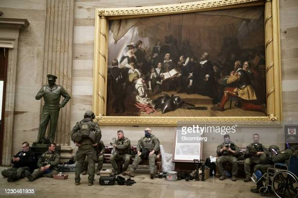Members of law enforcement rest in the U.S. Capitol in Washington D.C., U.S., on Wednesday, Jan. 6, 2021. The House and Senate resumed a politically...