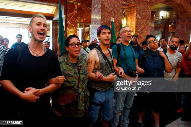 Members of LBGT community demonstrate against the Members of the National Union of Agricultural Workers during a protest against a painting called...