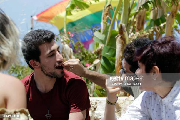Members of Lebanon's LGBTQ community attend a picnic the coastal city of Batroun north of Beirut on May 21 as part of the Beirut Pride week aimed at...