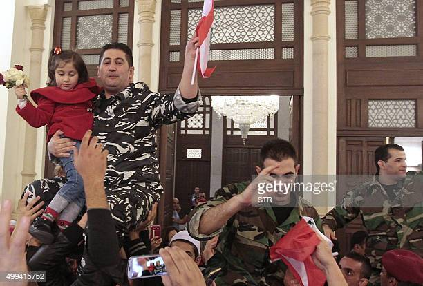 Members of Lebanons security forces who were kidnapped by jihadist groups in early August 2014 in the eastern border town of Arsal celebrate their...