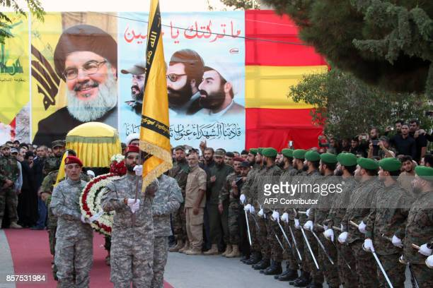 Members of Lebanon's Shiite Hezbollah movement carry the coffin of a fighter who was killed in combat against Islamic State group fighters in Syria...