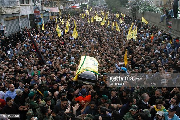 TOPSHOT Members of Lebanon's Shiite militant group Hezbollah carry the coffin of Mustafa Badreddine a top Hezbollah commander who was killed in an...