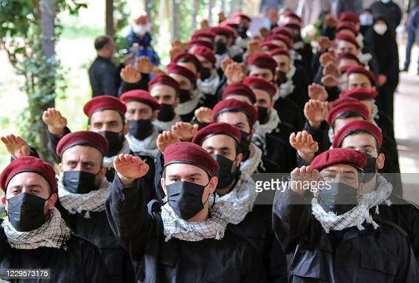 Members of Lebanon's Shiite movement Hezbollah take part in a Martyr's Day parade in the eastern Lebanese city of Baalbek on November 11, 2020.