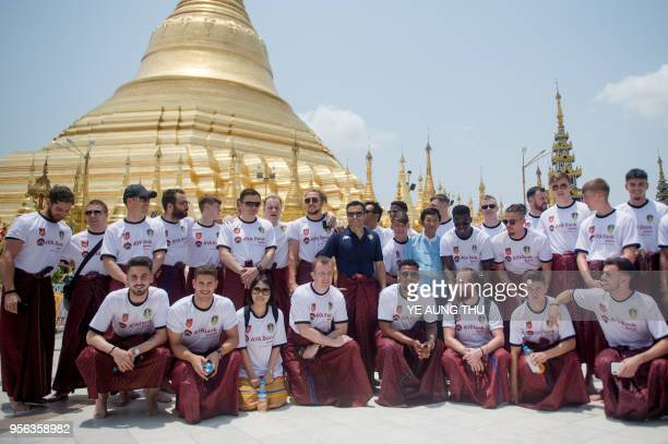 Members of Leeds United FC together with owner Andrea Radrizzani wearing traditional Myanmar longyi men's outfit pose for a group picture during a...