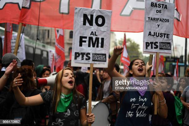 Members of leftist organizations demonstrate outside the National Congress against the government's negotiations with the IMF while legislators...