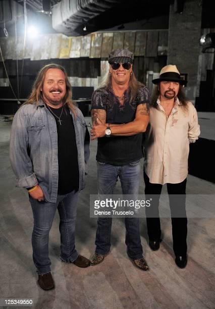 Members of legendary rock band Lynyrd Skynyrd Johnny Van Zant Gary Rossington and Rickey Medlocke during a tour of their new restaurant Lynyrd...