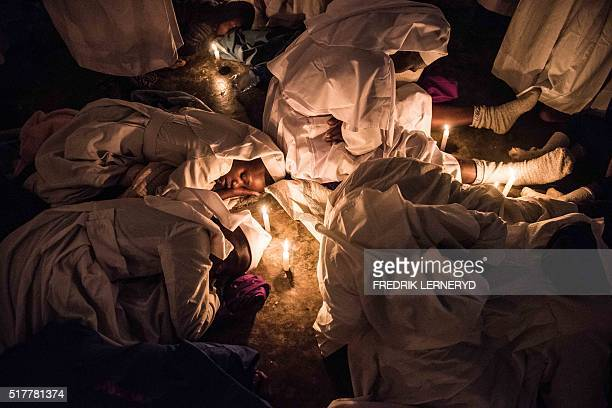Members of Legio Maria African Mission church attend a mass in their church building at Kibera slum at midnight coinciding with the hour of the...