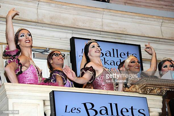 Members of Les Ballets Trockadero de Monte Carlo ring the opening bell at the New York Stock Exchange on December 24 2012 in New York City