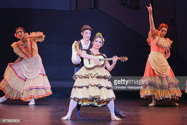 Members of 'Les Ballets Trockadero' perform on stage during the press call of the Les Ballets Trockadero de Monte Carlo at Komische Oper on July 19...