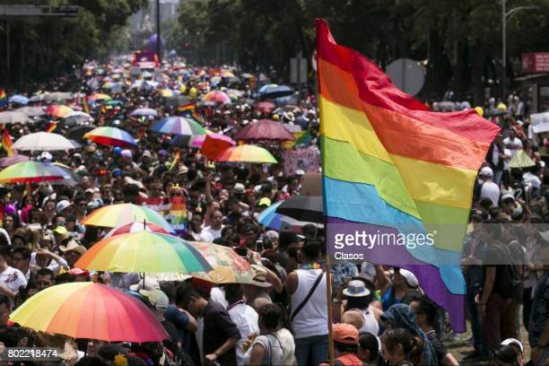 Members of Lesbian Gay Bisexual Transsexual Transgender and Intersex march during a Gay Pride Parade on June 24 2016 in Mexico City Mexico