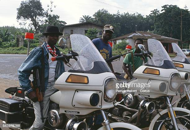 Members of Liberian president Samuel Doe's guard drive through the streets of Sinkor on HarleyDavidson motorcycles Responding to years of government...