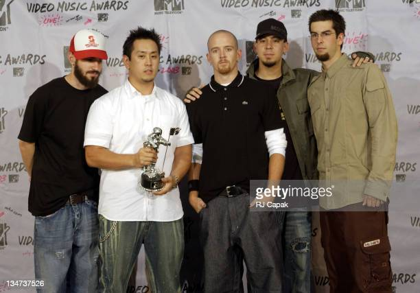 Members of Linkin Park pose after receiving the award for Best Rock Video of the Year for 'Somewhere I Belong' during the MTV Video Music Awards...