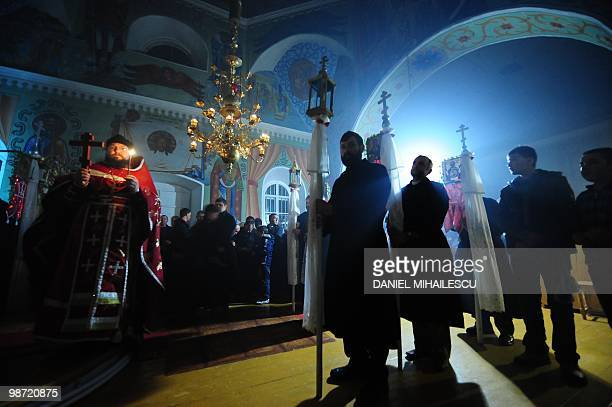 Members of Lipovene community a Russian origin minority group from Sarichioi village attend the Christian Orhodox religious service on the Easter...