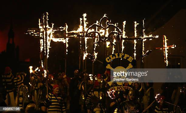 Members of local Bonfire societies parade through the streets of Lewes carrying lit crosses to celebrate Bonfire night on November 5 2015 in Lewes...