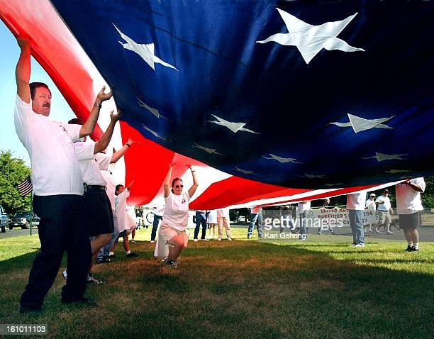 Members of Local Three Plumbers Union began to fold the giant American Flag they carried in Monday's Labor Day parade in Denver which wrapped up at...