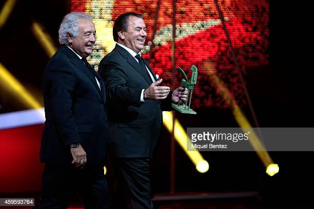 Members of 'Los del Rio' Antonio Moreno Monge and Rafel Ruiz Perdigones accept the 'Award for Career' during the 61st Ondas Awards 2014 on stage at...