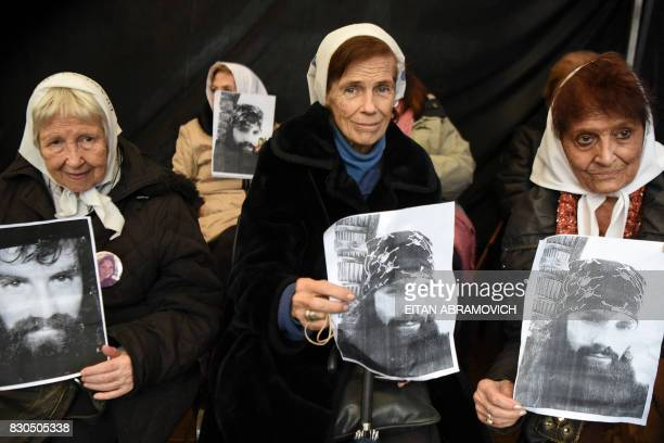 Members of Madres de Plaza human rughts organization Vera Jarach Laura Conde and Tati Almeida hold portraits of activist Santiago Maldonado...