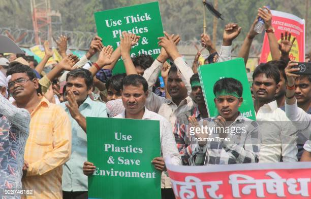 Members of Maharashtra Plastic Manufacturing Association and other plastic associations display placards during a protest against the blanket ban on...