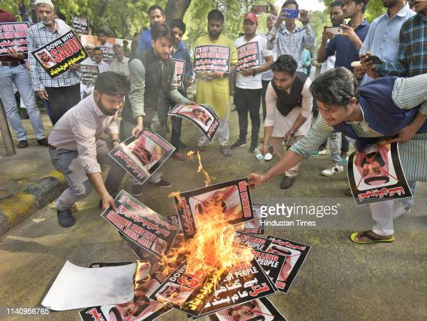 Members of MajliseUlamaeHind burn posters during a protest against mass execution of 37 people from Shia community in Saudi Arabia at Jantar Mantar...