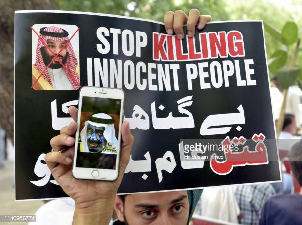 Members of MajliseUlamaeHind hold placards during a protest against mass execution of 37 people from Shia community in Saudi Arabia at Jantar Mantar...