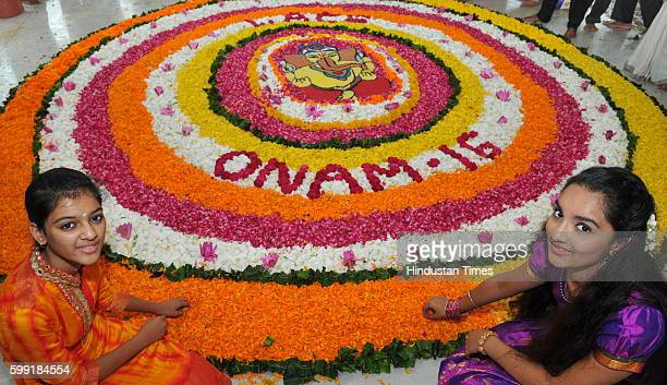 Members of Malayali community gather at Ayyappa Temple make rangoli with flowers and celebrate the start of Onam month on September 4 2016 in Indore...