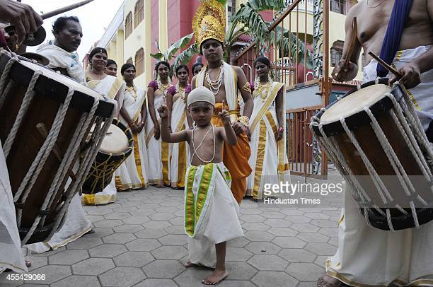 Members of Malayali Samaj clad in traditional dresses under the aegis of Ayyappa Charitable Society celebrate Onam on September 14 2014 in Indore...