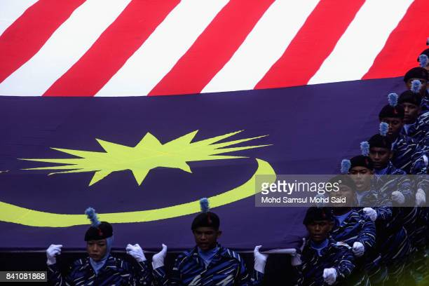 Members of Malaysian student hold the Malaysia flag during the 60th Merdeka Day celebrations at Merdeka Square on August 31 2017 in Kuala Lumpur...