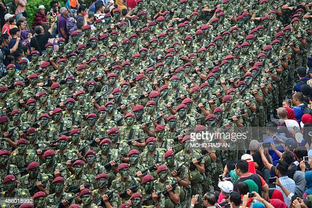 Members of Malaysia's military parade past during National Day celebrations at Independence Square in Kuala Lumpur on August 31 2015 Malaysia's...