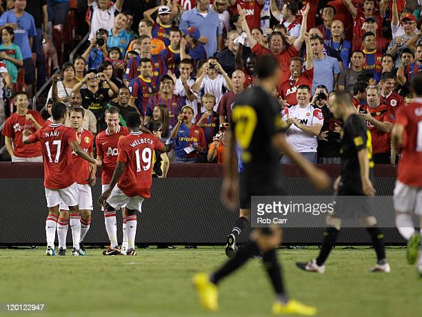 Members of Manchester United celebrate their second half goal against Barcelona during a friendly match at FedExField on July 30, 2011 in Landover,...