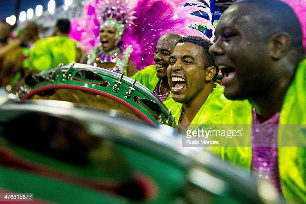 Members of Mangueira Samba School celebrate during their parade at 2014 Brazilian Carnival at Sapucai Sambadrome on March 02 2014 in Rio de Janeiro...