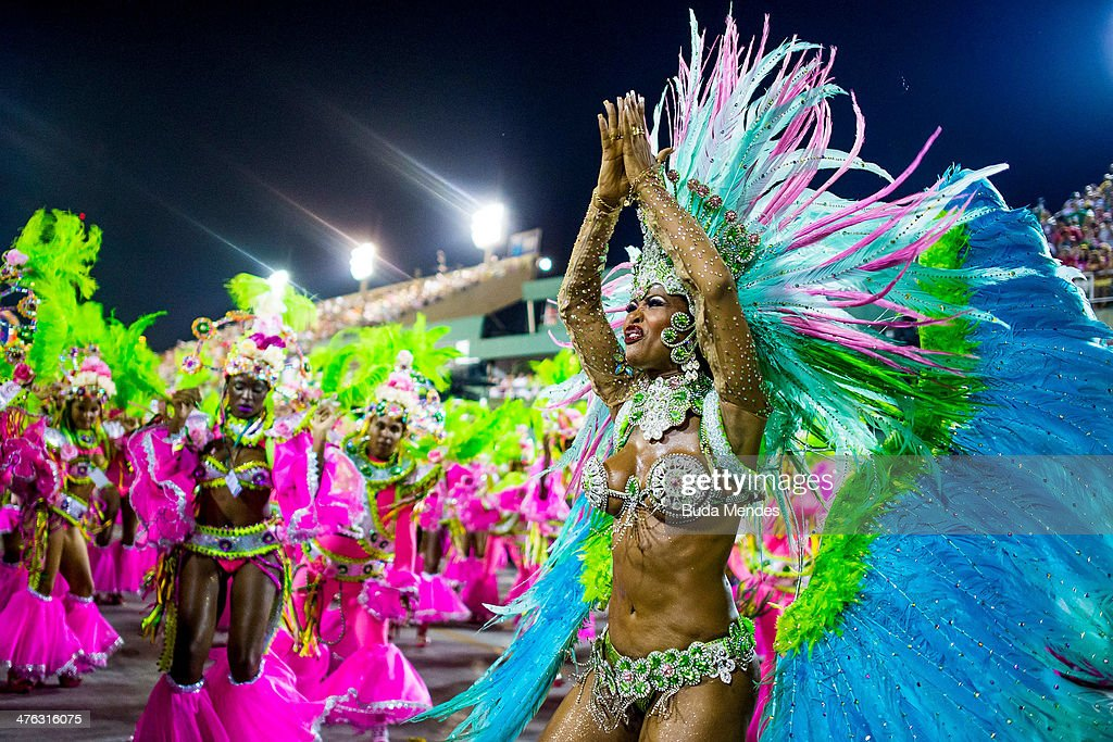 Members of Mangueira Samba School celebrate during their parade at 2014 Brazilian Carnival at Sapucai Sambadrome on March 02, 2014 in Rio de Janeiro, Brazil. Rio's two nights of Carnival parades begin on March 2 in a burst of fireworks and to the cheers of thousands of tourists and locals who have previously enjoyed street celebrations (known as 'blocos de rua') all around the city.