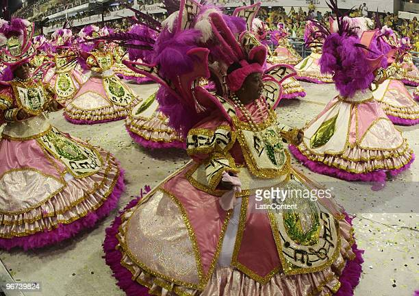 Members of Mangueira samba school dance along on their parade as part of the 2010 Carnival on February 16 2010 in Rio de Janeiro Brazil