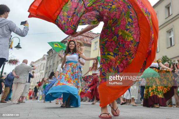 Members of 'Mazury' Polish Dance Group from Brasil during the traditional parade walk through the renovated 3rd May Street on the opening day of the...