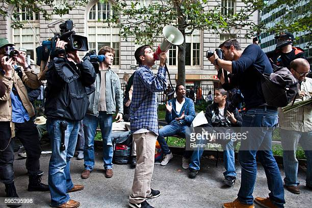Members of media photograph a demonstrator at Bowling Green Park in Lower Manhattan on Saturday, September 17, 2011. Organizers calling for 20,000...
