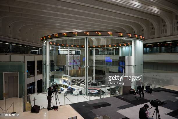 Members of media set up camera equipment at the Tokyo Stock Exchange , operated by Japan Exchange Group Inc. , in Tokyo, Japan, on Friday, Feb. 9,...