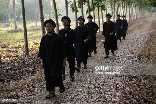 Members of men from the Islamic commune AnNadzir walk to attend Eid Al Adha mass prayer at Mawang Lake Gowa Regency on September 22 2015 in Makassar...