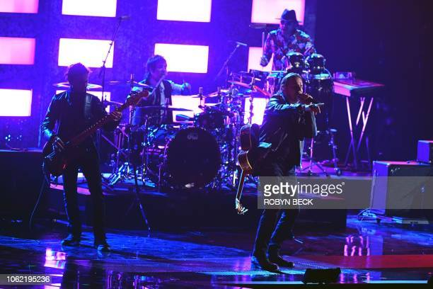 Members of Mexican band Mana and recipients of the Person of the Year award Fher Olvera Juan Calleros and Alex Gonzlez perform onstage during the...