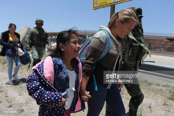 Members of Mexican National Guard detain Central American migrants trying to cross the Rio Bravo in Ciudad Juarez State of Chihuahua on June 21 2019...