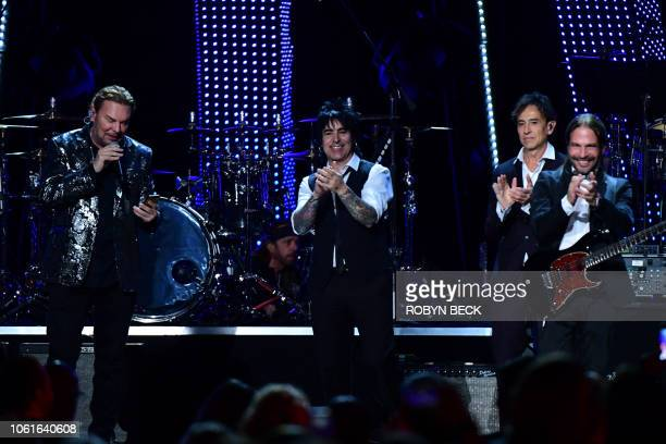 Members of Mexican rock group Mana Sergio Vallin Juan Calleros Fher Olvera and Alex Gonzalez wave after performing after receiving the 2018 Latin...