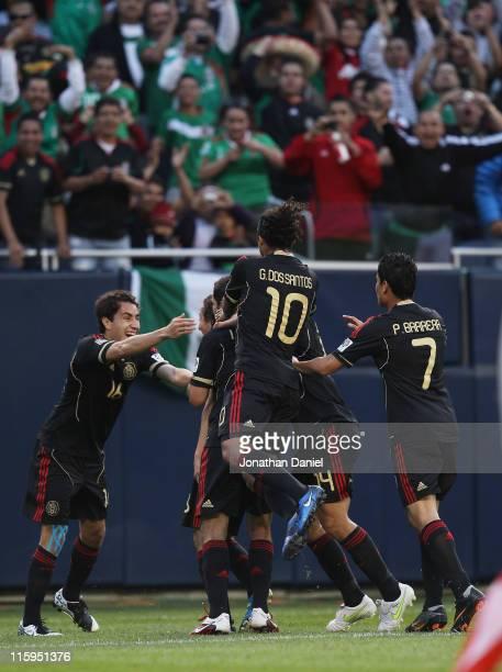 Members of Mexico including Efrain Juarez Giovani Dos Santos and Pablo Barrera celebrate a goal against Costa Rica during a CONCACAF Gold Cup 2011...