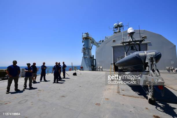 Members of mine hunting unit ' stand on the deck of the RFA Cardigan Bay ship during a joint demining drill between the US British an French Navy in...