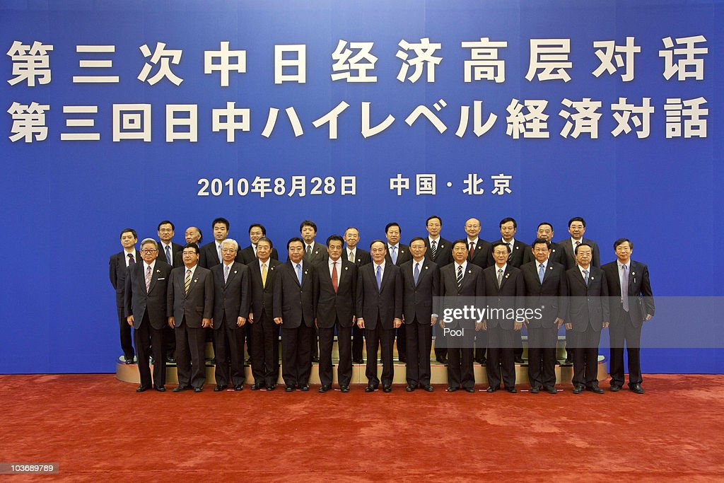 Members of ministerial teams from China and Japan pose for a group photo at the opening of the third China-Japan high level economic dialogue at the Great Hall of the People in Beijing, China 28 August 2010. The talks, led by China's Vice-Premier Wang Qishan (front row centre right with blue tie) and Japan's Foreign Minister Katsuya Okada (front row centre left with red tie), aim to cover a wide range of economic issues including trade in rare earth metals, essential for a number of high tech products such as hybrid auto engines and mobile phones.