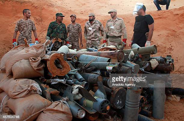 Members of Misrata and Zliten military college for engineering collect the unexploded weapons and ammunitions to destroy in Tripoli Libya on October...