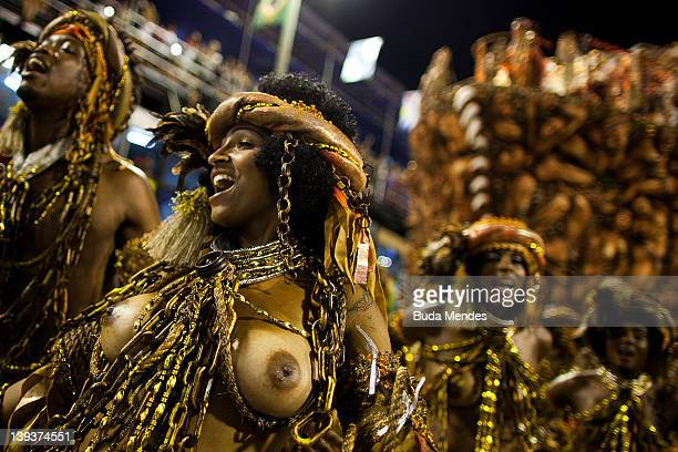 Members of Mocidade dance during the samba school's parade group A at Rio de Janeiro's carnival on February 20 2012 in Rio de Janeiro Brazil Carnival...