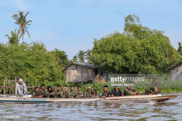 Members of Moro Islamic Liberation Front are seen on a boat in Bangsamoro, Cotabato, Philippines on August 19, 2019. After the territorial dominion...
