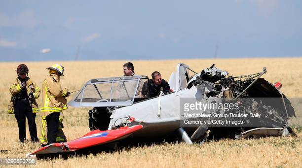 Members of Mountain View Fire and Lafayette Police look over the wreckage of an experimental airplane designed to look like a WWII vintage plane that...