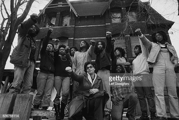 Members of MOVE a cult founded by John Africa avoid being arrested as they gather in front of their house in the Powelton Village section of...