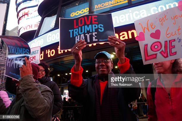 Members of MoveOnorg Political Action stand outside the studios of 'Good Morning America' to broadcast messages of love dignity and equality and...