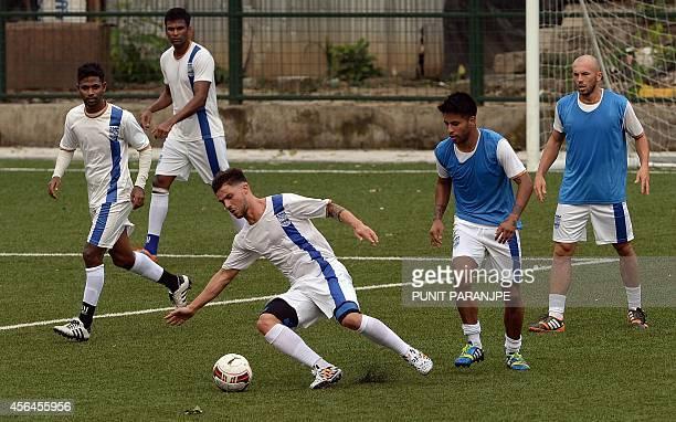 Members of Mumbai City Football Club team train at Cooperage Ground in Mumbai on October 1 2014 The Mumbai City FC begins play in October 2014 during...
