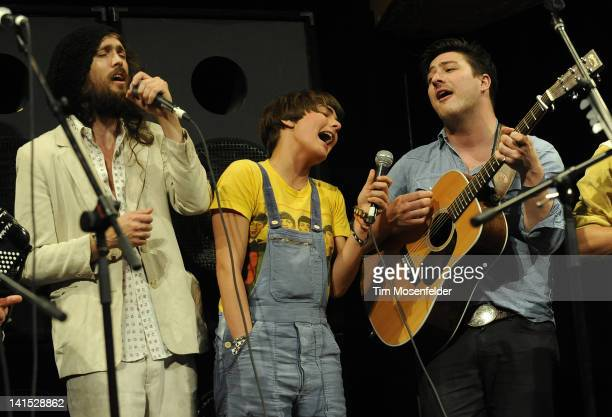 Members of Mumford Sons and Edward Sharpe and the Magnetic Zeroes Alex Ebert Jade Castrinos and Marcus Mumford perform at the premiere of The Big...